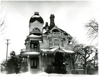 Large, ornate Victorian-style house known as the Gamwell House, with snowy roofs