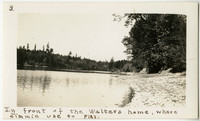 "Shoreline surrounded by trees with caption: ""In front of the Walters home, where Jimmie used to play."""