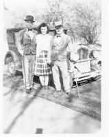 Two men and woman with model T