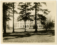 Exterior of Science Hall seen through trees and grounds, University of Washington