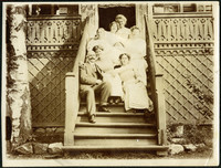 Family seated for portrait on exterior stairs