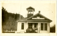 Postcard photo of Columbia Valley School with students and teacher standing on steps