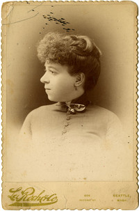 Studio portrait of woman in profile