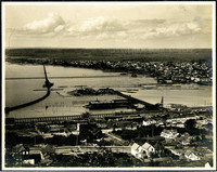 Left side of panorama triptych including Bellingham Bay from Sehome Hill showing Morse Hardware's dock and warehouse on wharf at center of image