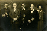 Musical group poses with instruments