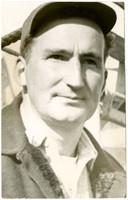 Close-up of unidentified man wearing baseball cap