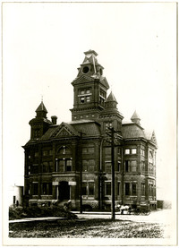 Front exterior of original Bellingham City Hall with horse and Sehome Laundry wagon parked in front