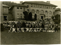 Students and faculty gather for photo on steps and sloping lawn in front of Old Main on campus of Bellingham Teachers' College