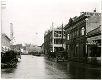 Looking north on Commercial street, Bellingham, Washington, toward Mt. Baker theater under construction witwh extensive scaffolding