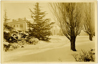 Snow-covered lawn and Larrabbee mansion