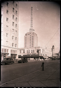 The Bellingham Hotel (now Bellingham Towers)seen from the intersection of West Champion and Grand Streets with the Hotel Rockwood and Peoples Market below, and Mount Baker Theater in background