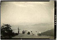 Eight people look out over San Juan Islands from top of Mt. Constitution, Orcas Island