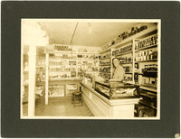 Roseberg, Oregon store - interior of mercantile with Dayton P. Weaver behind counter