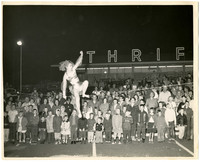 An unidentified woman doing a high wire act in front of Thriftway in Fairhaven, Washington