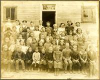 Two women teachers and group of schoolchildren