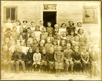 Two women teachers and group of schoolchildren