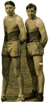 Two men in athletic track uniforms pose next to each other