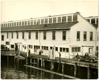 Bellingham Canning Company - long warehouse with multiple windows on pier