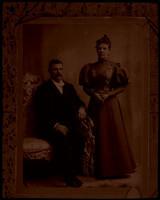Andrew and Christing Ecklund in formal attire  pose for studio portrait