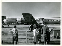 A Pan American World Airways plane loading at the gate at an unidentified airport.