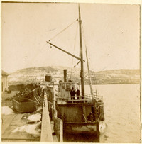 """Small steamship """"Union"""" pulled up to dock with two men standing at helm on the Fraser River"""