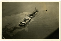 Aerial view of steamship Feltre sinking in Columbia River with plume of fuel in surrounding waters