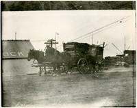 Horse-drawn wagon hauling split wood near Cornwall Street dock