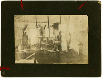 Interior industrial scene with water-bath grinding wheel and chain cradle