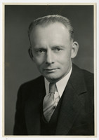 Studio portrait of George Karlson in suit and tie