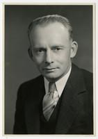 Studio portrait of George Karlson in suit and tie