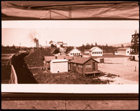 Negative of entrance to Bellingham Coal Mine with several wooden structures, Bellingham, WA