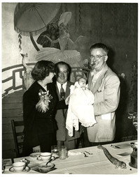 Two men, a woman and a baby at the Bellingham Hotel on Commercial Street