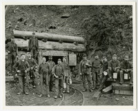 Thirteen miners pose at entrance of Blue Canyon Coal , Mine, south Lake Whatcom, WA
