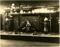 Display window outside Wahl's Department Store shows mannequins in fancy dress