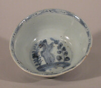 Blue bowl decorated with trees, rocks
