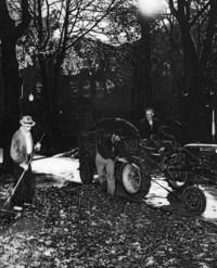 1945 Old Main: Raking Leaves