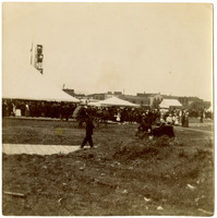 Crowds gather under circus tents