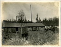 Long wooden building - apparently a bunkhouse or the back side of a rural lumber mill
