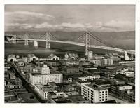 View from above of Oakland, CA, and San Francisco - Oakland Bay Bridge, looking west towards Yerba Buena Island