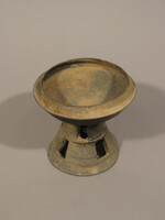 Waisted lidded vessel with two rows of four rectangular slots in stem: stem