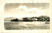 View of waterfront of Saint Petersburg, Alaska with cannery, public dock, downtown in background