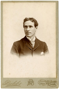 Formal studio portrait of Thomas G. Newman