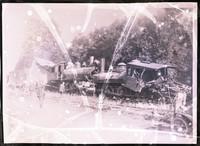 Several men examine a head-on train collision