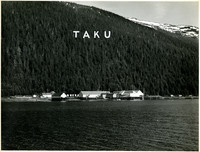 Pacific American Fisheries cannery and wharf at base of mountain at remote Taku, Alaska