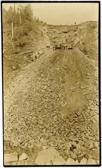 Rock-crushing operation cuts through hillside