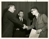North C. Burn of Waldron, Washington receives graduation certificate.