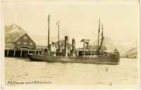 """Two fishing vessels, """"S.S. Canada"""" and """"S.S. Imbricaria"""" are moored at docks of King, Cove, AK"""