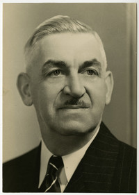 Portrait of older man with small moustache