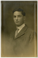 Studio portrait of adolescent boy in suit