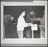 "Unidentified woman with ""Silverstitcher,'  (stitching machine for box construction), possibly Bornstein Seafoods worker"